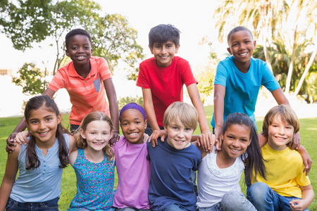 kids studying: Happy friends in the park on a sunny day Stock Photo