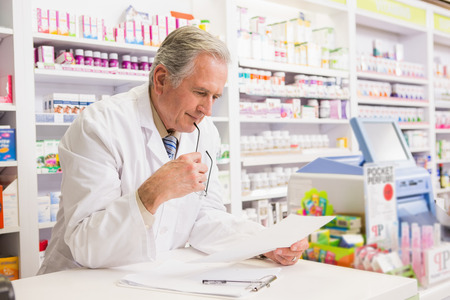 Senior pharmacist reading prescription in the pharmacy