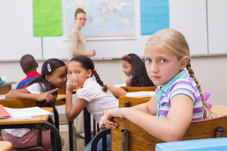 Naughty pupils in class at the elementary school
