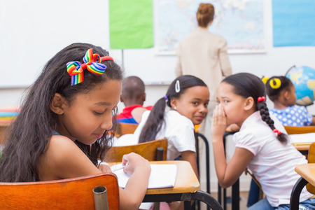 misbehaving: Naughty pupils in class at the elementary school
