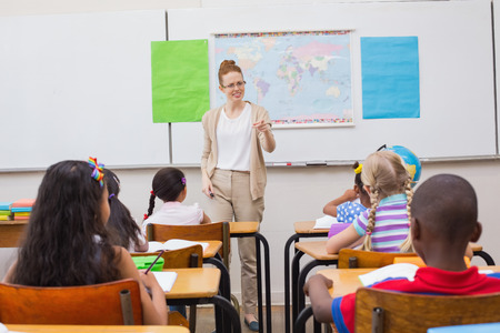 Angry teacher looking pupil at the elementary school Stock Photo