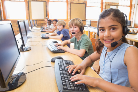 early education: Cute pupils in computer class at the elementary school