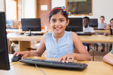 elementary school student: Cute pupils in computer class at the elementary school