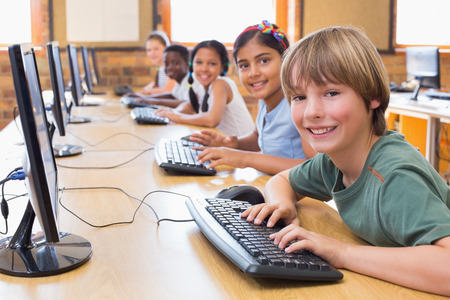 computer classroom: Cute pupils in computer class at the elementary school