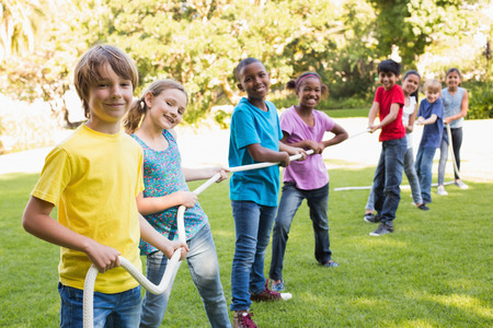 multiracial children: Happy friends playing in the park on a sunny day
