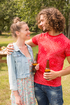 weekend activity: Happy friends in the park having barbecue on a sunny day Stock Photo