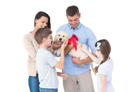 gifting: Happy family with dog over white background