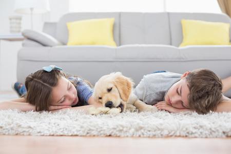rug: Siblings sleeping with dog on rug at home