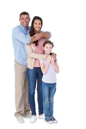 one family: Portrait of happy family embracing each other over white background