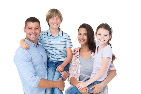 Portrait of happy parents carrying children over white background