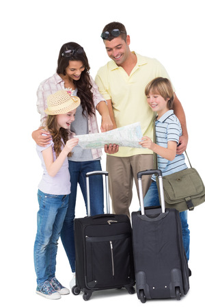 exploring: Happy family with luggage exploring map over white background
