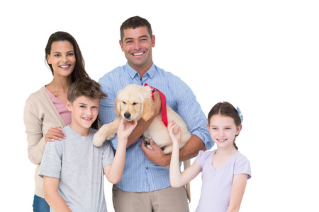 Portrait of happy parent and children with dog over white background photo