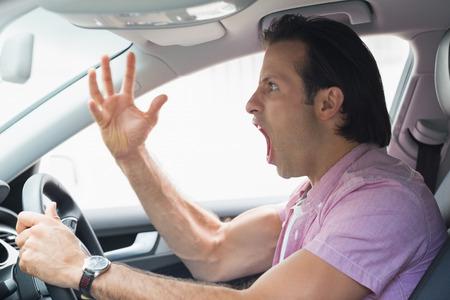 road rage: Man having road rage in his car