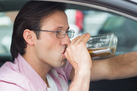 life threatening: Man drinking alcohol while driving in his car