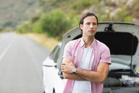 road assistance: Man waiting assistance after a car breakdown at the side of the road Stock Photo
