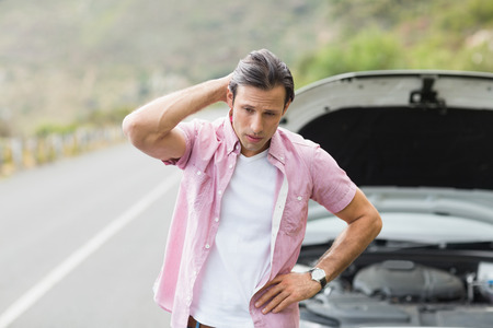 breakdown: Stressed man waiting assistance after a car breakdown at the side of the road