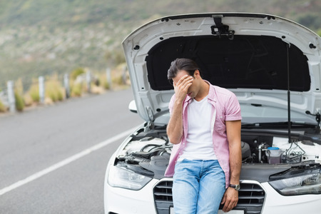 apprehensive: Desperate man after a car breakdown at the side of the road Stock Photo