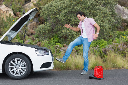apprehensive: Angry man after a car breakdown at the side of the road