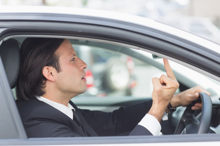 rage: Businessman experiencing road rage in his car Stock Photo