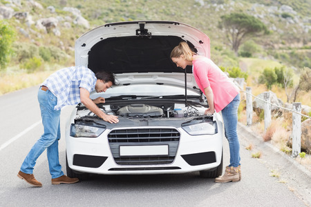 engine bonnet: Couple after a car breakdown at the side of the road
