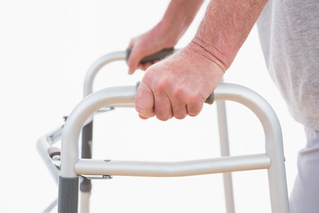 male  man: Senior man walking with zimmer frame