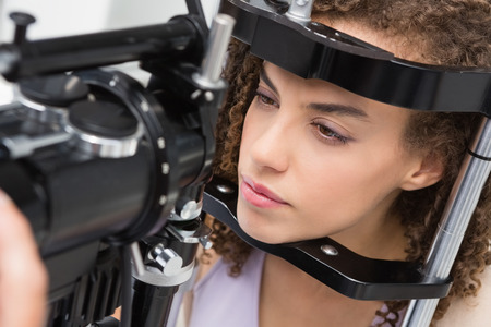 eye service: Woman doing eye test in medical office Stock Photo