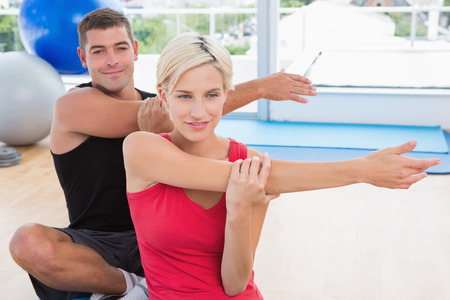 fit couple: Happy fit couple working in fitness studio Stock Photo