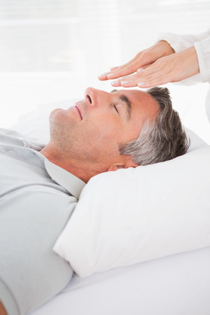 reiki: Patient in therapy in medical office
