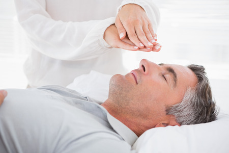 Therapist working with man in medical office Banco de Imagens