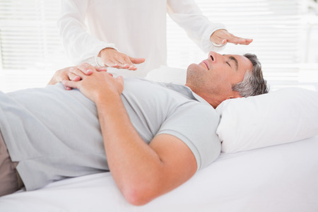alternative healing: Therapist working with man in medical office Stock Photo