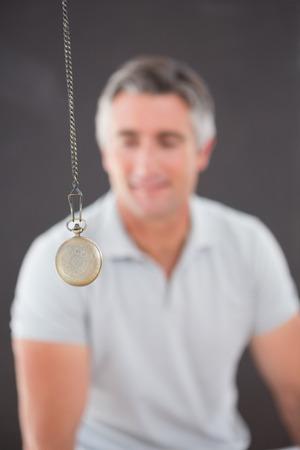 Man being hypnotized  with pendulum