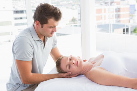 spa woman: Woman receiving neck massage in spa centre