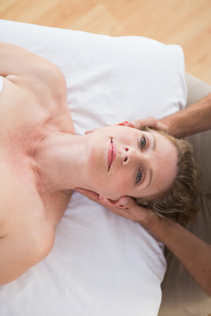 neck massage: Woman receiving neck massage in spa centre
