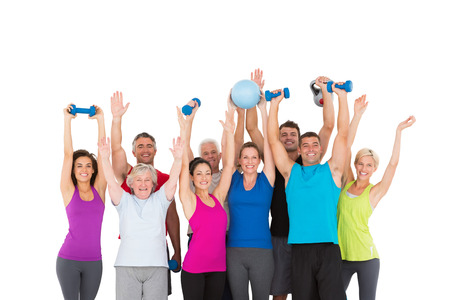 Cheerful people holding exercise equipment on white background Foto de archivo