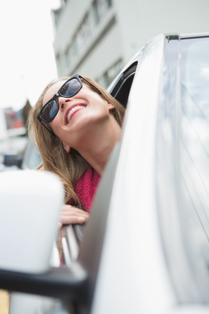 drivers seat: Happy woman in the drivers seat in her car