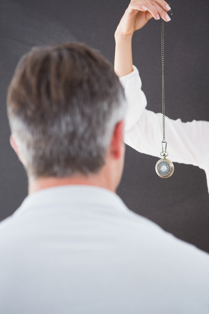hypnotherapy: Man being hypnotized  with pendulum
