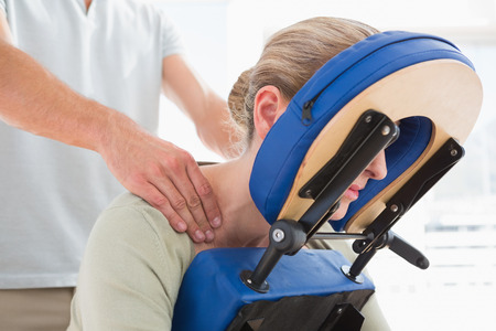 Woman having back massage in medical office Stock Photo