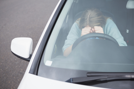 rage: Young woman experiencing rage in her car