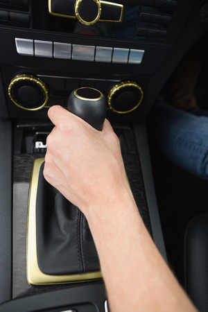gearshift: Woman using gearshift in her car