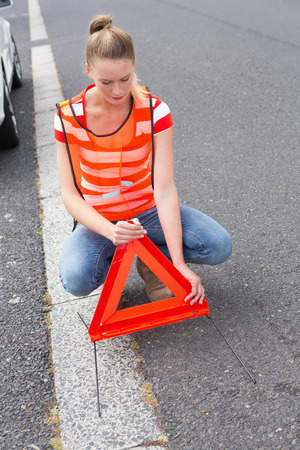 broken down: Triangle warning sign with broken down car Stock Photo