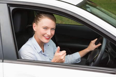 drivers seat: Smiling businesswoman sitting in drivers seat in her car Stock Photo