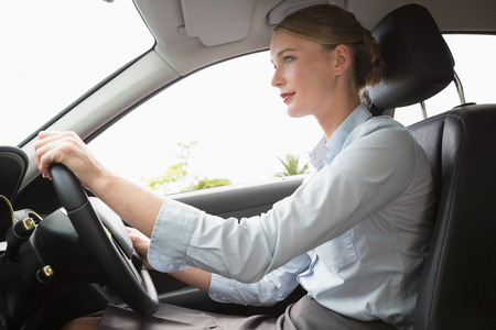 Businesswoman sitting in drivers seat in her car