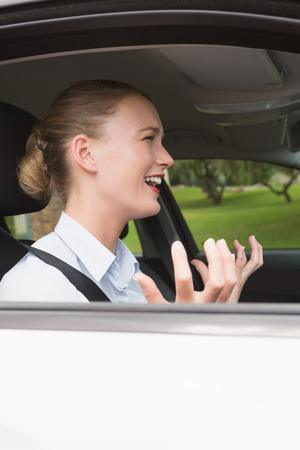 road rage: Young businesswoman experiencing road rage in her car Stock Photo