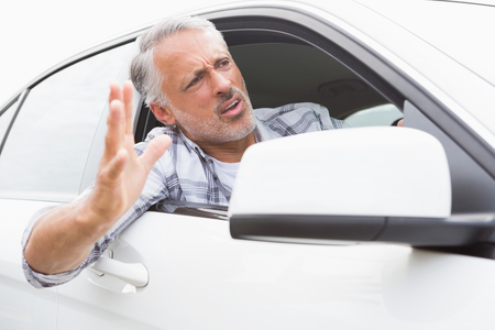 rage: Man experiencing road rage in his car Stock Photo