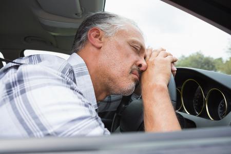 slumped: Drunk man slumped on steering wheel in his car