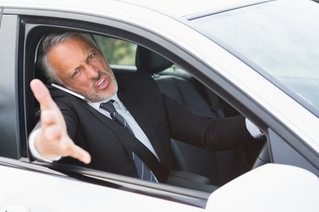 road rage: Businessman experiencing road rage in his car Stock Photo