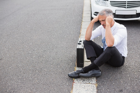 breaking down: Sad man waiting for assistance after breaking down on the road