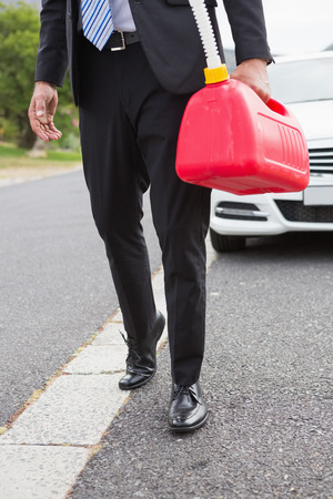 broken down: Man bringing petrol canister after broken down on the road