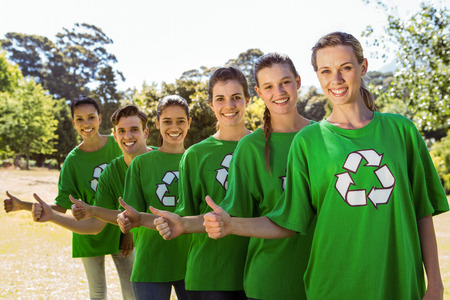 activists: Environmental activists smiling at camera on a sunny day