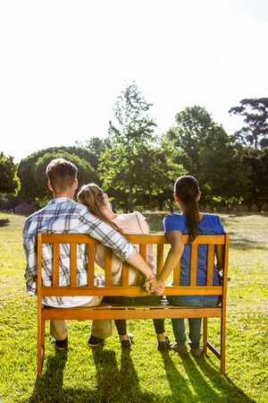 unfaithful: Man being unfaithful in the park on a sunny day on a sunny day